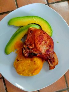 Fried porkchop with mofongo and avocado.